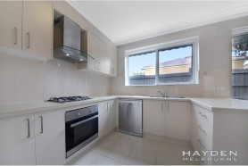 Secure and Stunning fully renovated townhouse in a premier location!